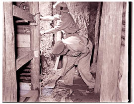 Army recruits in training, trench preparation.