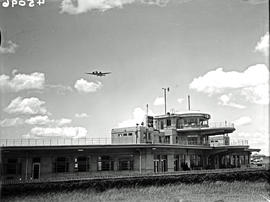 Johannesburg, 1938. Rand airport. SAA Junkers Ju-86 in flight over terminal building.