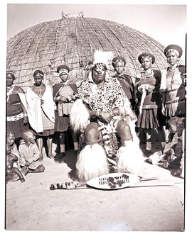Natal, 1946. Zulu chief with his wives in front of hut.