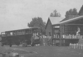 Vryburg, 1923. SAR truck No 666 loading milk cans.