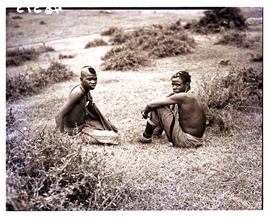 Transkei, 1940. Two males sitting.
