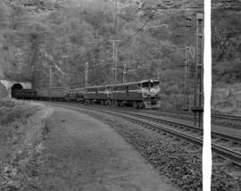 Natal, 1963. Passenger train double-headed by SAR Class 5E emerging from tunnel on the Natal main...
