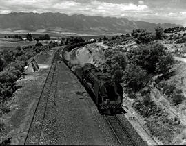 Tulbagh district, 1950. SAR Class 15F with main line passenger train leaving Tulbagh Road station.