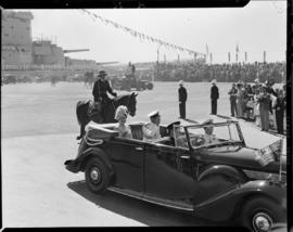 Cape Town, 17 February 1947. King George VI and Queen Elizabeth leaving Table Bay Harbour in open...