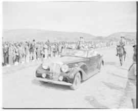 Lobatsi, Bechuanaland, 17 April 1947. King George VI and Queen Elizabeth drive through welcoming ...