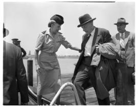 Vaal Dam, November 1949. BOAC Solent G-AHIX 'City of Edinburgh'. Hostess assisting passenger from...