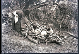 Natal South Coast, 1934. Preparing the fire for baking clay pots.