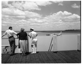 Vaal Dam, circa 1949. Arrival of BOAC flying boat Solent G-AKNS. Three people on jetty.