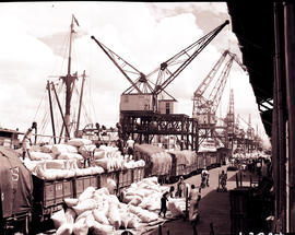 """1936. Loading of bags on train in harbour."""