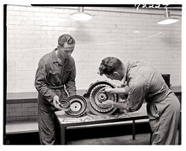 """Johannesburg, 1962. Apprentices assembling clutch and thrust bearing in Road Transport Serv..."