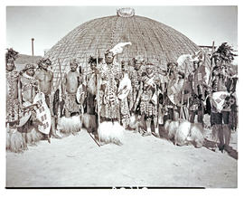 Natal, 1946. Zulu chief with his headmen in front of hut.