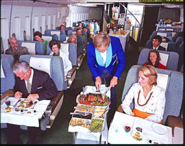 SAA Boeing 747. Food being served in first class compartment.