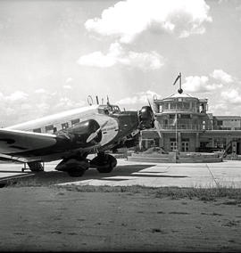 Johannesburg, 1935. Rand airport. SAA Junkers Ju-52 ZS-AFD 'Sir Benjamin D'Urban' in foreground w...