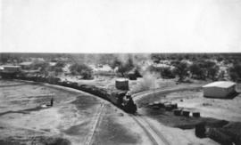 South-West Africa, 1937. Narrow gauge train hauled by SAR Class NG15  entering station.