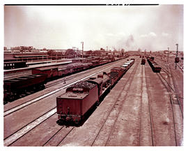 Springs, 1949. Station yard with SAR Class 12A No 1532 pushing goods wagons.