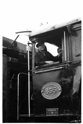 Johannesburg, April 1969. Driver in cabin of SAR Class 16E No 855 at Braamfontein.