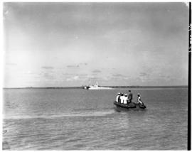 Vaal Dam, May 1948. Arrival of BOAC Solent flying boat G-AHIN 'Southampton'. Porters on luggage b...