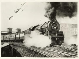 Johannesburg, 1936. SAR Class 16E No 858 with Union Limited departing from station.