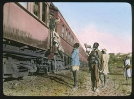 Botswana. Buying native curios from a train.
