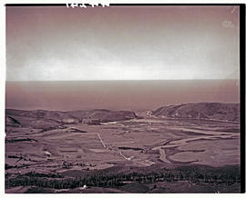 """Knysna, 1936. Aerial view over river, lagoon and the Heads."""