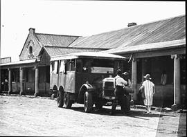 Vryburg, 1923. Loading milk cans at creamery onto Thornycroft truck.