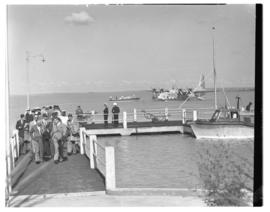 Vaal Dam, May 1948. Arrival of BOAC Solent flying boat G-AHIN 'Southampton'. Passengers on jetty.