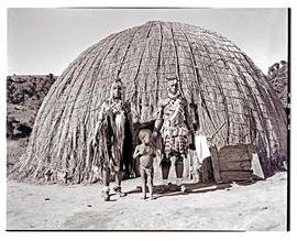 Natal, 1946. Zulu family in front of hut.