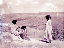 """Transkei, 1954. Three women smoking."""