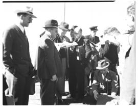 Vaal Dam, circa 1948. Group of about 35 men on tour. Passengers on jetty.