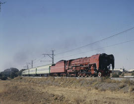 Bloemfontein district. SAR Class 26 No 3450 'Red Devil' with passenger train.