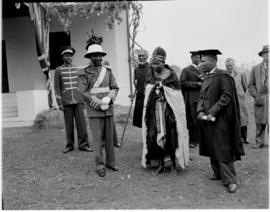 Swaziland, 25 March 1947. Paramount Chief Sobhuza II (with pith helmet) and local dignitaries.