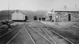 Laingsburg, 1895. Station buildings with steam locomotive and station staff in the distance looki...