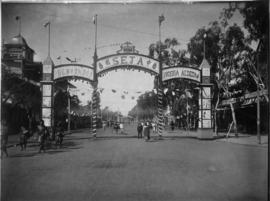 Royal tour by Crown Prince of Portugal, July 1907. Arch in wide street.