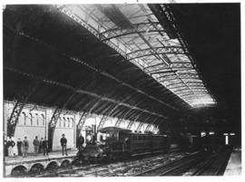 Cape Town, 1874. Station interior with R & W Hawthorn & Co No. 10 'Ebden' with a passenge...