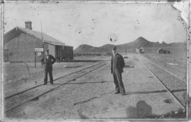 Biesiespoort, circa 1893. Stationmaster AI Mok on the left with assistant.