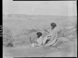 Transkei, 1954. Two women smoking pipes.