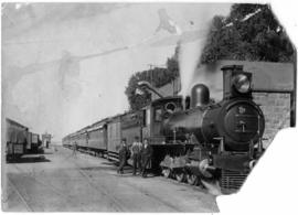 Modder River, 1904. Three men posing next to Cape 6th Class, later SAR Class 6J in station.
