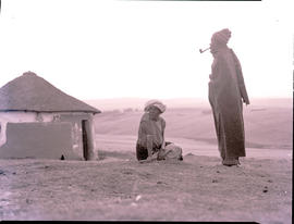"""Transkei, 1954. Man and woman at hut."""
