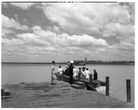 Vaal Dam, circa 1949. Arrival of BOAC flying boat Solent G-AKNS. Luggage boat at jetty.