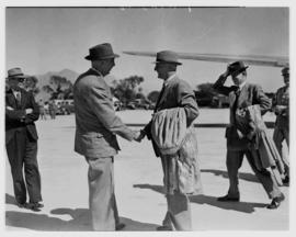 May 1946. Trip to Cape Town with SAA Douglas DC-4 ZS-AUA 'Tafelberg', men greeting outside aircraft.