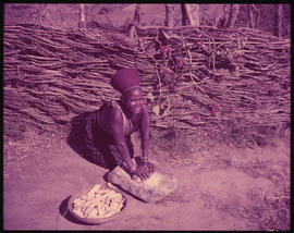 Eshowe district. Zulu woman grinding mealies in the Nkwaleni Valley.