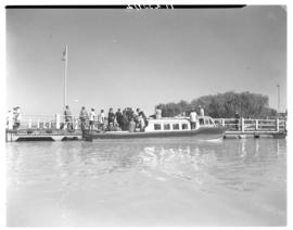 Vaal dam, circa 1948. Group of about 35 men on tour. Passengers disembarking from passenger boat.