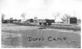 Naboomspruit district, circa 1924. Duff's tent camp with goods wagon on roadrail line, circa 1924...