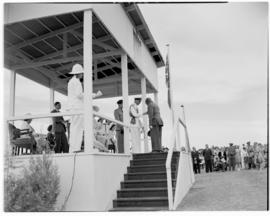 Lobatsi, Bechuanaland, 17 April 1947. King George VI greeting man on dais.