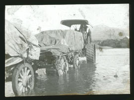 Tractor with trailer fording drift.