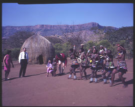 Zulu dancing for tourists in traditional village.