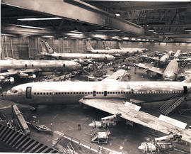 Boeing 707's being assembled in factory.