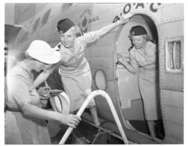 Vaal Dam, November 1949. BOAC Solent G-AHIX 'City of Edinburgh'. Hostesses assisting passenger in...