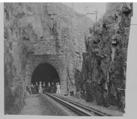 Waterval-Boven. Railway tunnel western portal with well dressed group of people.